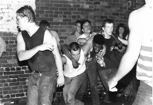 Jon Stewart in the pit at an early '80s DK show