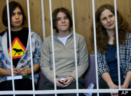 Maria Alekhina, Yekaterina Samutsevich, Nadezhda Tolokonnikova in jail. AP Photo/Alexander Zemlianichenko