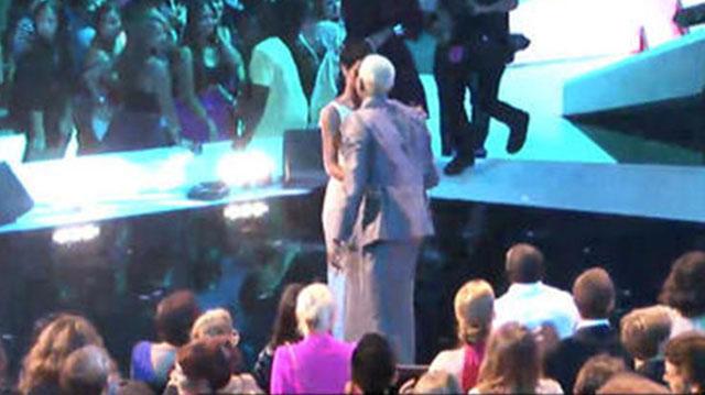 Rihanna and Chris Brown kiss