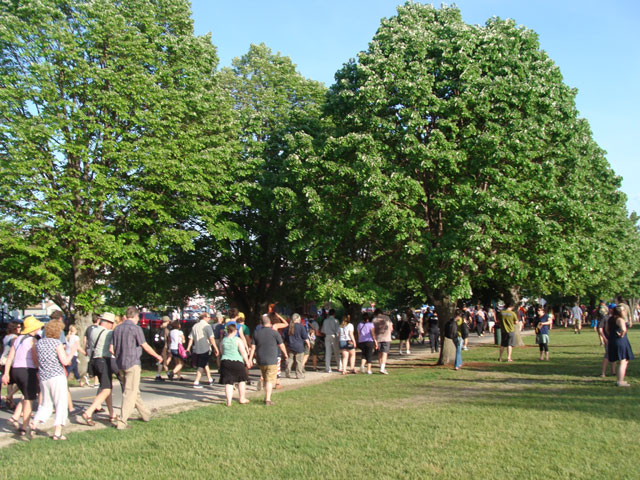 The crowd disperses through Waterfront Park